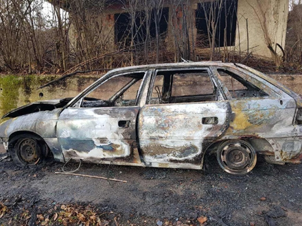 Zapaljena Opel Astra nakon ubistva FOTO: Twitter/Balkan Insight